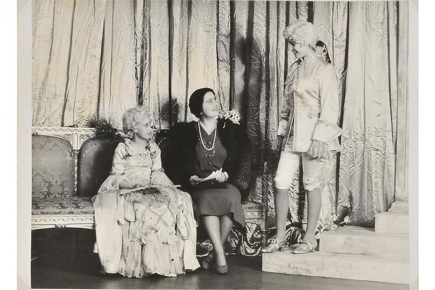 A handout reproduction picture released by Dominic Winter Auctioneers on Dec 4, 2013, shows a photograph of the then Princess Elizabeth (right) (now Queen Elizabeth II), Princess Margaret (left) andthe Queen Mother (centre)on the se