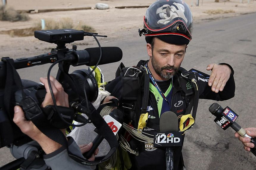 After joining nearly 200 skydivers on a group jump, skydiver Martial Ferre, of France, talks about the jump that killed two skydivers after they collided in midair during a jump from Skydive Arizona at Eloy Municipal Airport, on Wednesday, on Dec 4,