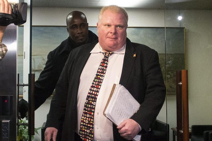 Mayor Rob Ford arrives at city hall in Toronto on Nov 19, 2013. Weeks before the public first became aware of Mr Ford's crack video, the disgraced politician may have tried to buy it, according to court documents made public on Wednesday. -- FILE PHO