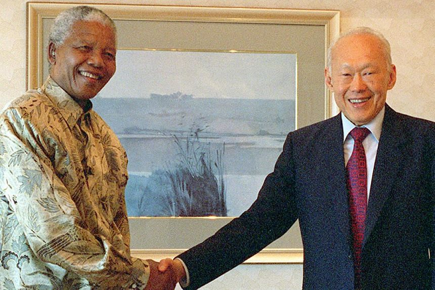 Former Singapore Prime Minister Lee Kuan Yew and South Africa President Nelson Mandela. It has been more than 16 years since Mr Mandela set foot in Singapore in 1997 and left his mark with a hybrid orchid that bears his name. -- FILE PHOTO: