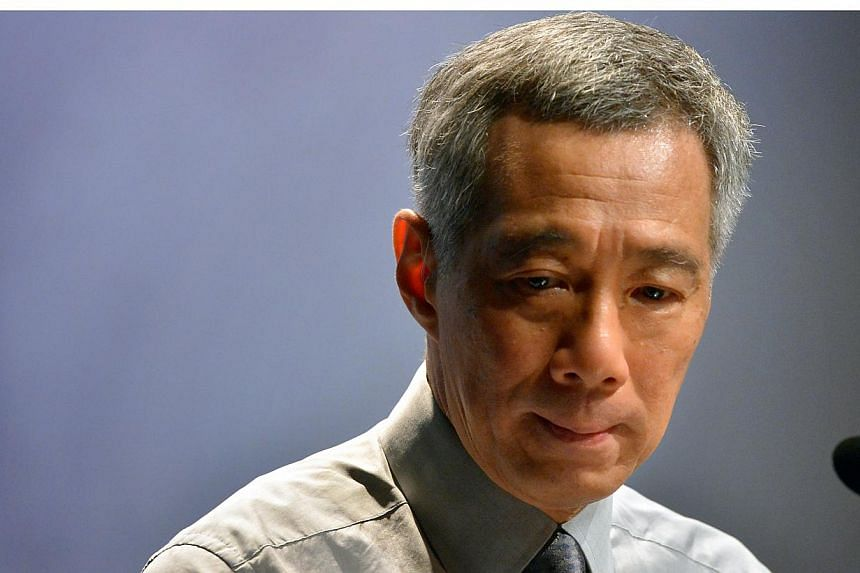 Singapore Prime Minister Lee Hsien Loong (above) paid tribute to the late Nelson Mandela on Friday morning, hailing the anti-apartheid icon as an inspiration to millions. -- ST FILE PHOTO: KUA CHEE SIONG