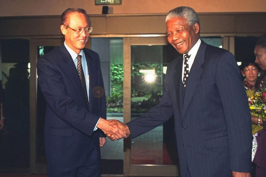 Then Singapore Prime Minister Goh Chok Tong welcoming Mr Nelson Mandela, then president of South Africa, during his one-hour stop-over in Singapore en route to South Africa in 1995 after official visits to Japan and South Korea. -- ST