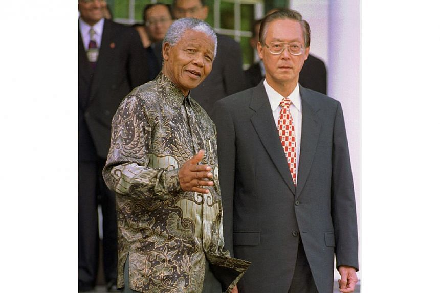 Then Singapore prime minister Goh Chok Tong and Mr Nelson Mandela, then president of South Africa, at Tuynhuys, Capetown in 1997. They later joined the Singapore delegation for discussions. -- ST FILE PHOTO: ALPHONSO CHAN