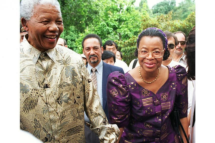Mr Nelson Mandela, then president of South Africa, andhis wife Graca Machel (right) during a visit to Singapore. It has been more than 16 years since Mr Mandela set foot in Singapore in 1997 and left his mark with a hybrid orchid that bears his