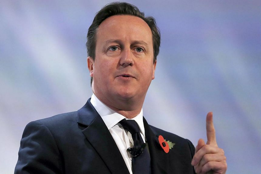 """Britain's Prime Minister David Cameron speaks at the annual Confederation of British Industry conference in central London, Nov 4, 2013.Mr Cameron on Thursday said """"a great light had gone out"""" following Mr Nelson Mandela's death, revealing that"""