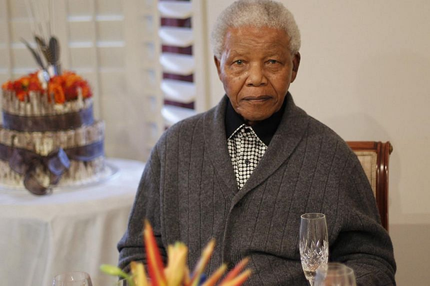 Former South African President Nelson Mandela looks on as he celebrates his birthday at his house in Qunu, Eastern Cape, July 18, 2012.Mr Mandela, the revered icon of the anti-apartheid struggle in South Africa and one of the towering political