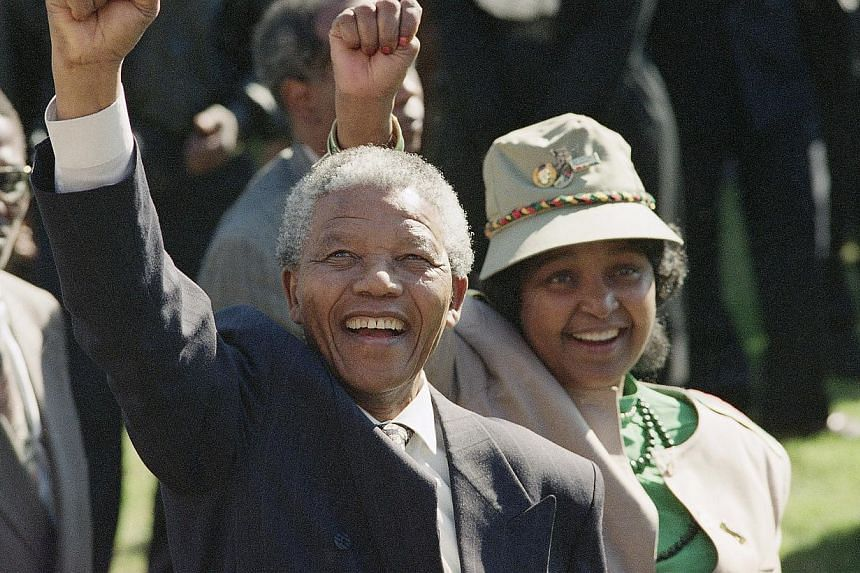 African National Congress President Nelson Mandela and his wife, Winnie, greet the crowd after arriving at a rally and a week-long national ANC conference held inside South Africa for the first time in 30 years, July 7, 1991.UN leader Ban Ki Mo