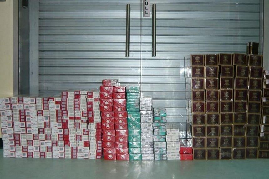 245 cartons of duty-unpaid cigarettes were recovered from the Singapore-registered car on Nov 27, 2013.-- PHOTO: SINGAPORE POLICE FORCE