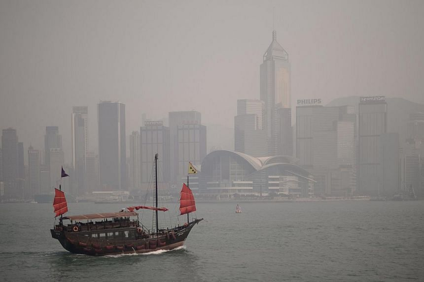 A junk sails past the city's skyline shrouded in a dense blanket of toxic smog on April 15, 2013.Hong Kong on Friday, Dec 6, 2013, announced a new air quality health index, the first in Asia to use the system, in its ongoing battle to combat ai