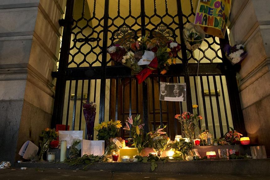 Floral tributes are laid in memory of Nelson Mandela outside the South African High Commission in London on Friday, Dec 6, 2013.Palestinian president Mahmud Abbas paid tribute on Friday to Mr Mandela's commitment to his people's cause as he mou