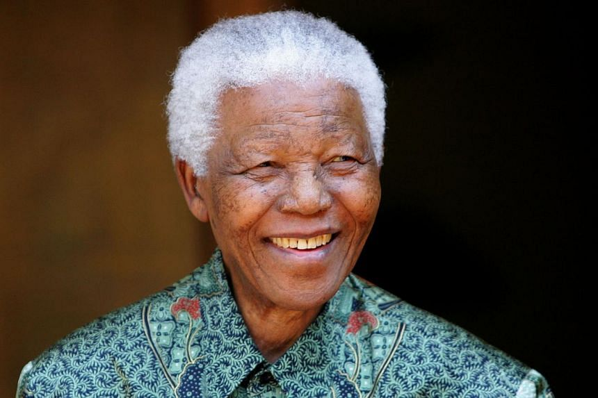 """In 2008, just before his 90th birthday, the United States gave Nelson Mandela (above) a special present, striking him from a decades-old terror watch list and ending what US officials called """"a rather embarrassing matter."""" -- FILE PHOTO: REUTER"""