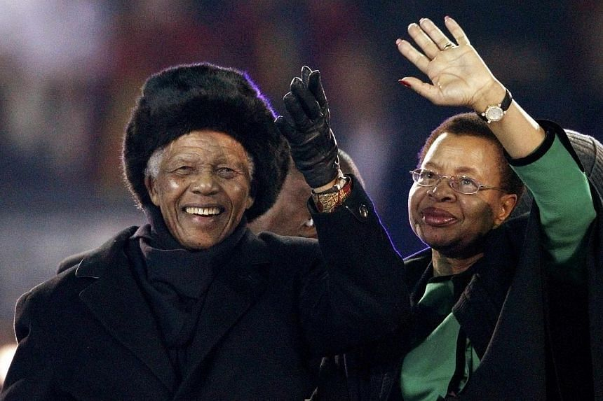 Former South African president Nelson Mandela and his wife Graca Machel wave to the crowd at Soccer City stadium during the closing ceremony for the 2010 World Cup in Johannesburg on July 11, 2010.It was on his inauguration day in 1994 that the
