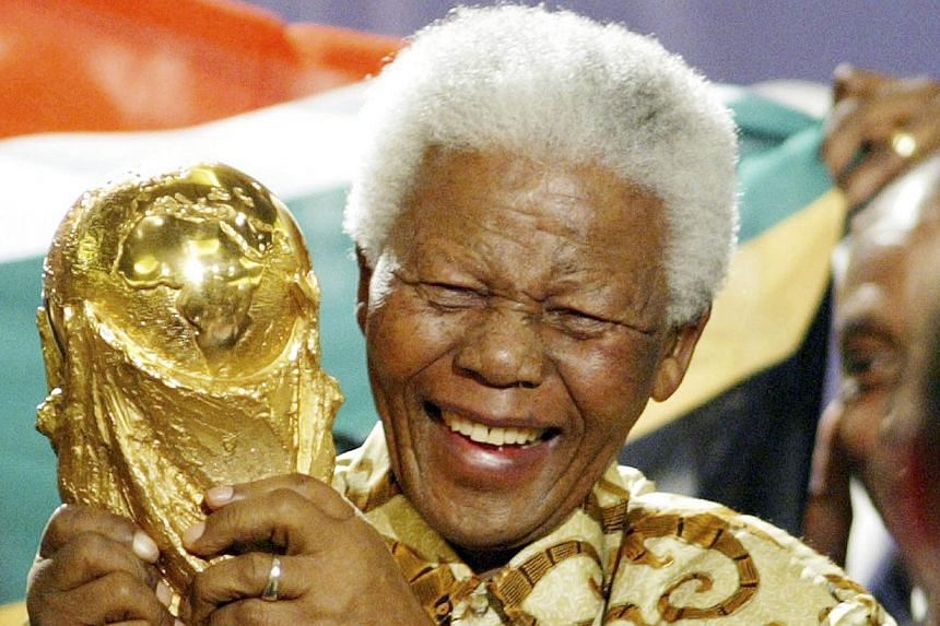 Former South African President Nelson Mandela lifts the World Cup trophy in Zurich, Switzerland, after FIFA's executive committee announced that South Africa would host the 2010 FIFA World Cup soccer tournament. Mandela was pivotal in helping the cou