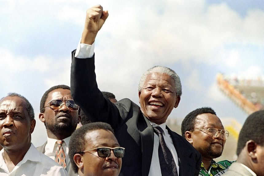 President of the African National Congress (ANC) Nelson Mandela raises a clenched fist to supporters upon his arrival for an election rally ahead of the April 27 general elections in Mmabatho, Mar 15, 1994. South Africa's President Jacob Zuma said, T