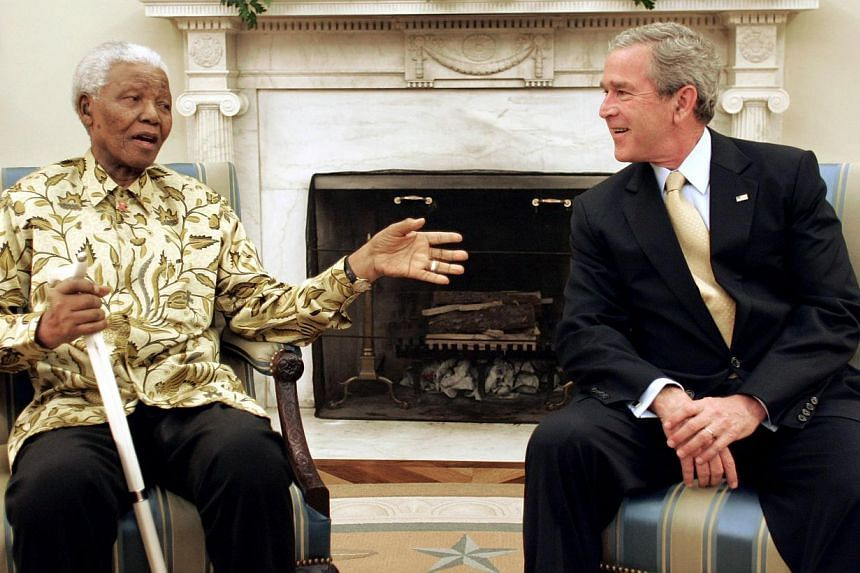 Then US President George W. Bush meets with former South African president Nelson Mandela (left) in the Oval Office of the White House, May 17, 2005. South Africa's president Jacob Zuma says, Thursday, Dec 5, 2013, that Mr Mandela has died. He was 95