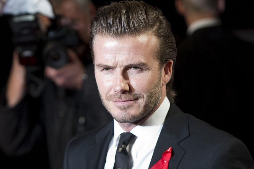 """Former England football captain David Beckham: """"We have lost a true gentleman and a courageous human being. It was truly an honour to have known a man who had genuine love for so many people.""""-- FILE PHOTO: REUTERS"""