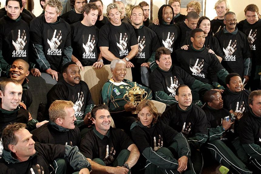 """The South African Rugby Union: """"He used the 1995 Rugby World Cup, the first major sporting event to be hosted in SA after the 1994 democratic elections, as an instrument of change to help promote unity amongst all South Africans.""""-- FILE PHOTO:"""