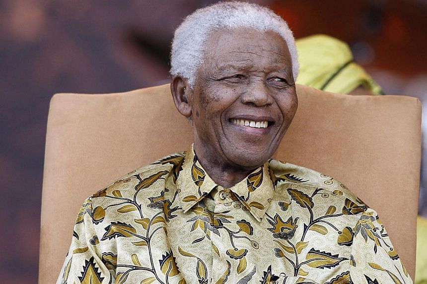 Former South African President and Nobel peace prize laureate Nelson Mandela listening to African National Congress (ANC) president's remarks during his 90th birthday celebrations at Loftus stadium in Pretoria, South Africa on Aug 2, 2008. South Afri