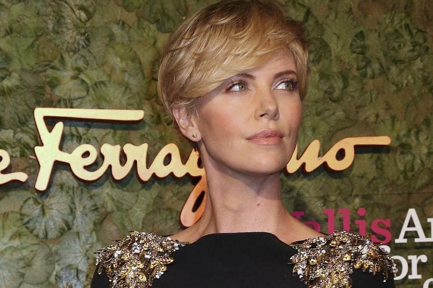 """South African actress Charlize Theron: """"Rest in Peace Madiba. You will be missed, but your impact on this world will live forever.""""-- FILE PHOTO: AP"""