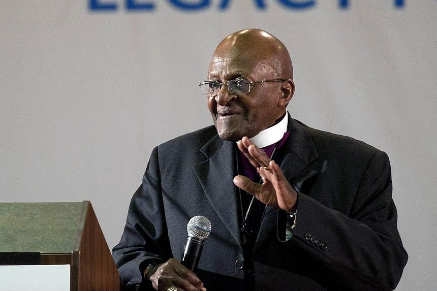 """Archbishop Desmond Tutu: """"He was a unifier from the moment he walked out of prison. He taught us how to come together and believe in ourselves."""" -- FILE PHOTO: AFP"""