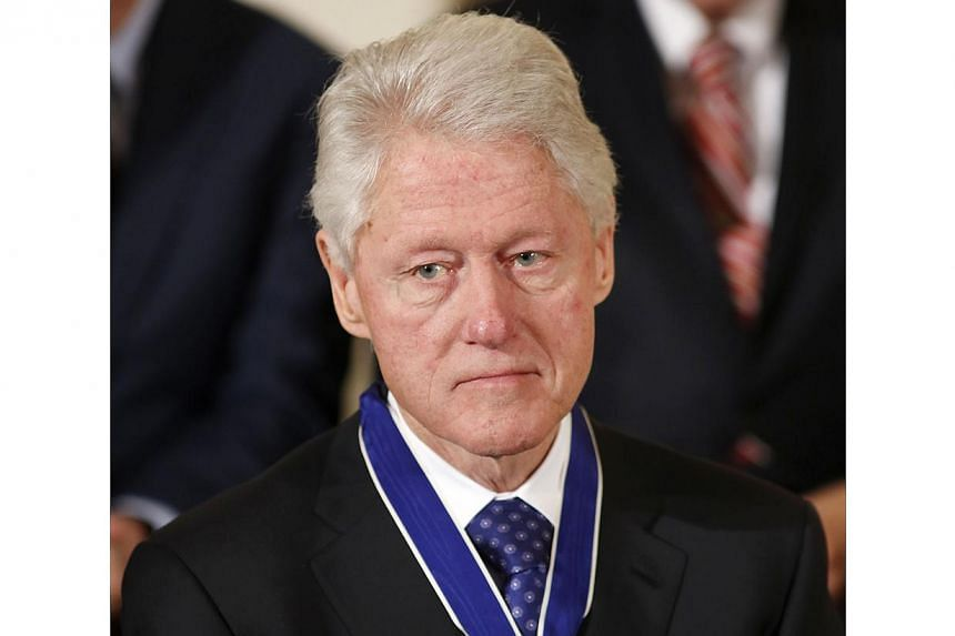 """Former US president Bill Clinton: """"History will remember Nelson Mandela as a champion of human dignity and freedom, for peace and reconciliation.""""-- FILE PHOTO: REUTERS"""