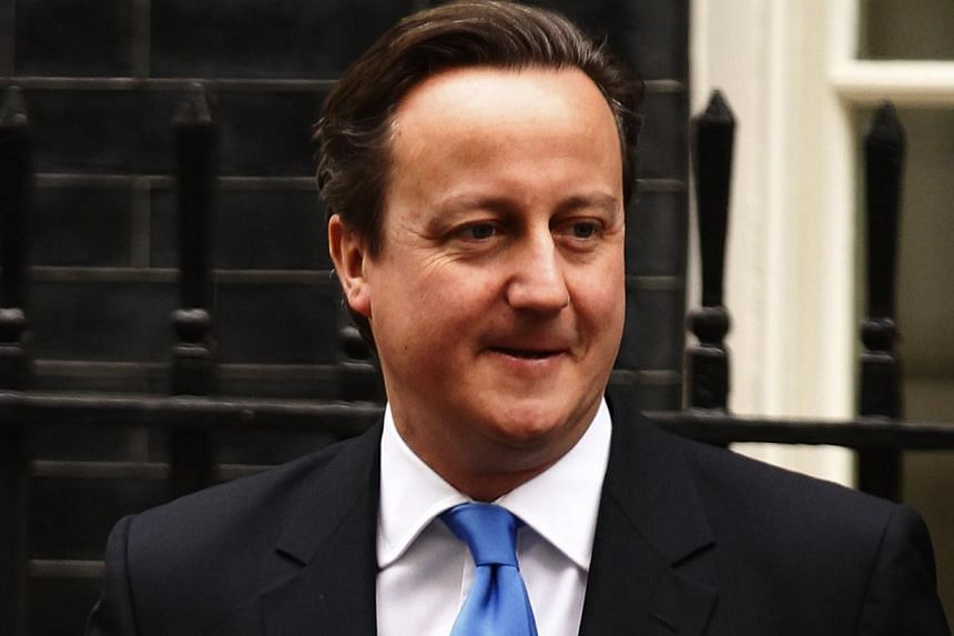 """British Prime Minister (PM) David Cameron: """"A great light has gone out in the world.""""-- PHOTO: REUTERS"""