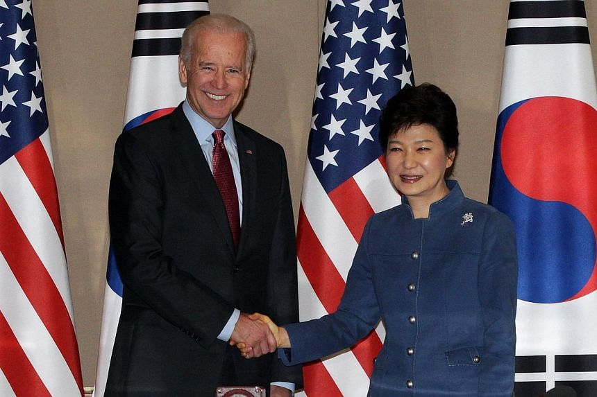 South Korean President Park Geun-Hye (right) shakes hands with US Vice President Joe Biden before their meeting at the presidential Blue House in Seoul, on Dec 6, 2013.Vice President Joe Biden said on Friday, Dec 6, 2013, there should be no dou