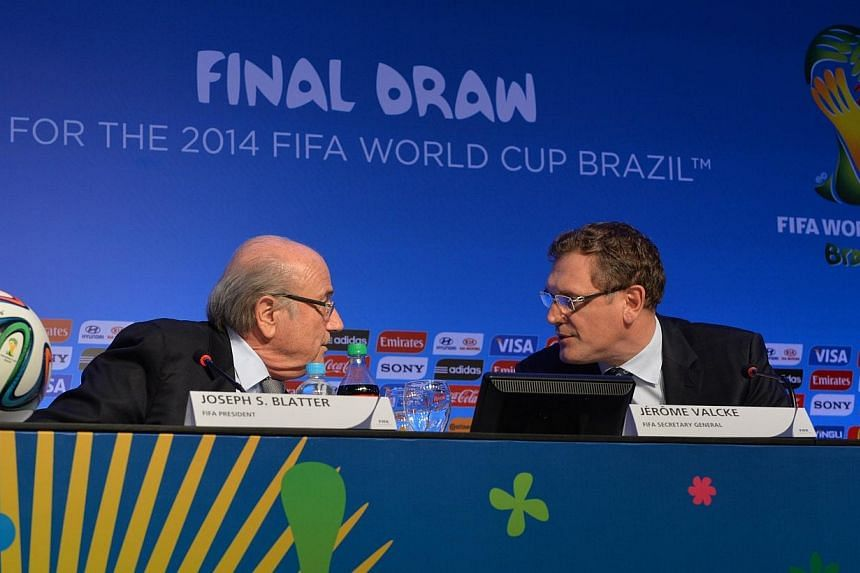 FIFA President Sepp Blatter (left) and FIFA General Secretary Jerome Valcke chat during a press conference on the eve of the Brazil 2014 FIFA Football World Cup final draw, in Costa do Sauipe, state of Bahia, on Dec 5, 2013. World Cup organisers said