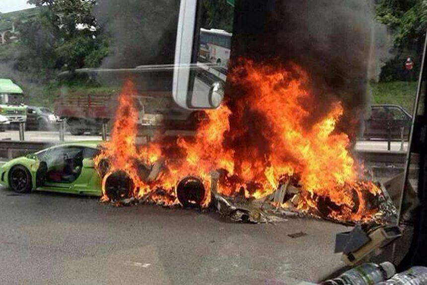 Three Lamborghinis burst into flame during an accident at Kilometre 260 along the North-South Expressway near Seremban on Friday morning, Dec 6, 2013. -- PHOTO: STOMP