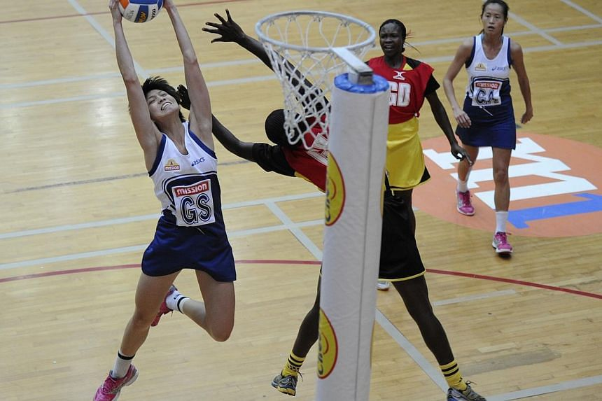Team Singapore and Uganda battle for positions as finals are just one match away, on Dec 4, 2013. Singapore's netballers will play for the Nations Cup trophy on Saturday after a 75-23 thrashing of the United States on Fridaynight, Dec 6, 2013,