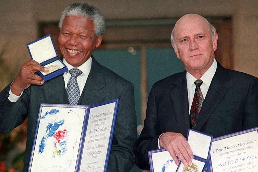 South African Deputy President F.W. de Klerk (right) and South African President Nelson Mandela pose with their Nobel Peace Prize Gold Medals and Diplomas in Oslo, on Dec 10, 1993. The Norwegian Nobel committee paid tribute on Friday, Dec 6, 2013, to