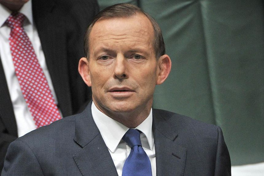 """Australian Prime Minister Tony Abbott on Friday hailed Mr Nelson Mandela as """"a truly great man"""" after the anti-apartheid hero died in South Africa aged 95. -- PHOTO: AP"""