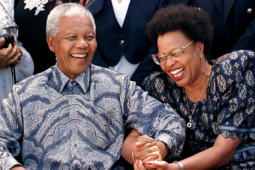 South African President Nelson Mandela (left) and his companion Graca Machel share a light moment before setting sail on board the QE II cruise ship in Durban harbour in this March 29, 1998 file photo. -- FILE PHOTO: REUTERS
