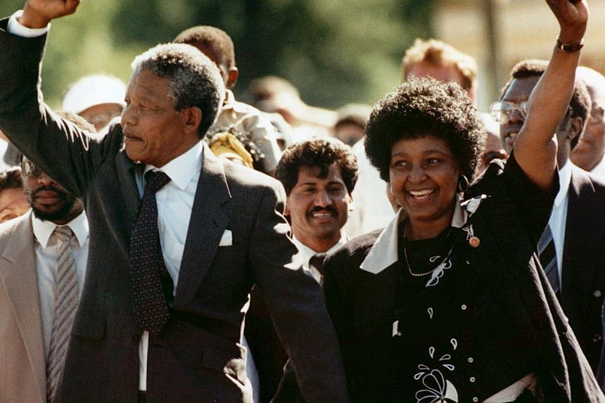 Mr Nelson Mandela and his wife, Ms Winnie Madikizela-Mandela, raise clenched fists as they walk hand-in-hand upon his release from prison in Cape Town, South Africa, in this Feb 11, 1990 file photo. -- FILE PHOTO: AP