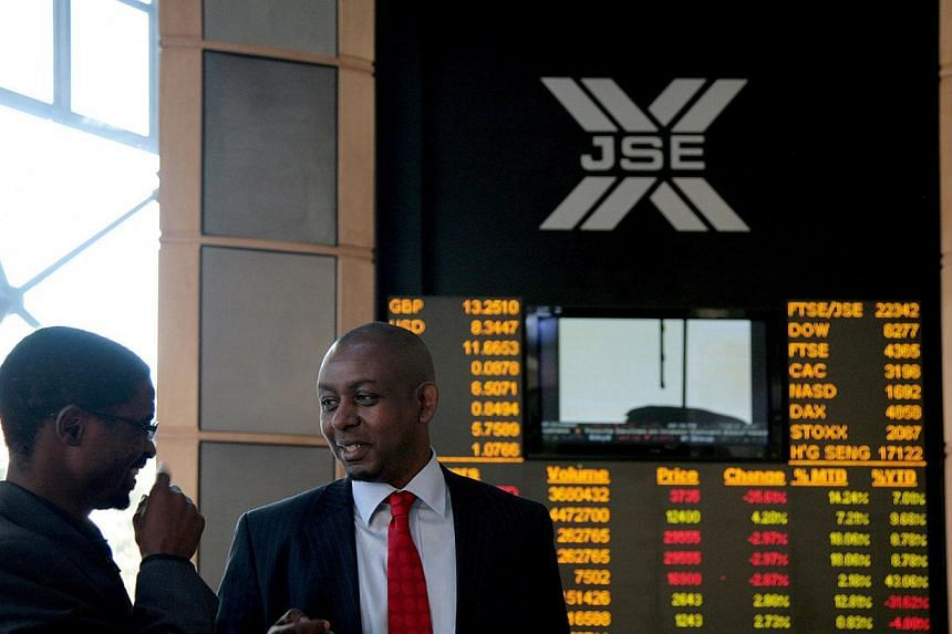 Economists slapped down speculation that Mr Nelson Mandela's death could prompt an economic and financial slump in South Africa, but warned the gains he inspired remain fragile. -- PHOTO: BLOOMBERG