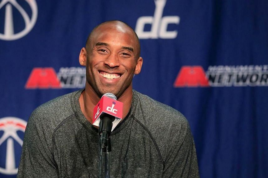Kobe Bryant of the Los Angeles Lakers talks with the media during a news conference before the start of the Lakers and Washington Wizards game at Verizon Center on Nov 26, 2013 in Washington, DC. Bryant will make his long-awaited return from inj