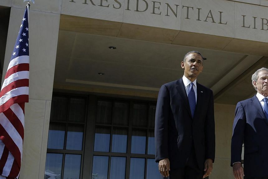 President Barack Obama (left) and former president George W. Bush arrive for the dedication of the George W. Bush Presidential Center Thursday, April 25, 2013, in Dallas.Mr Obama and his predecessor, Mr Bush, will travel to South Africa next we