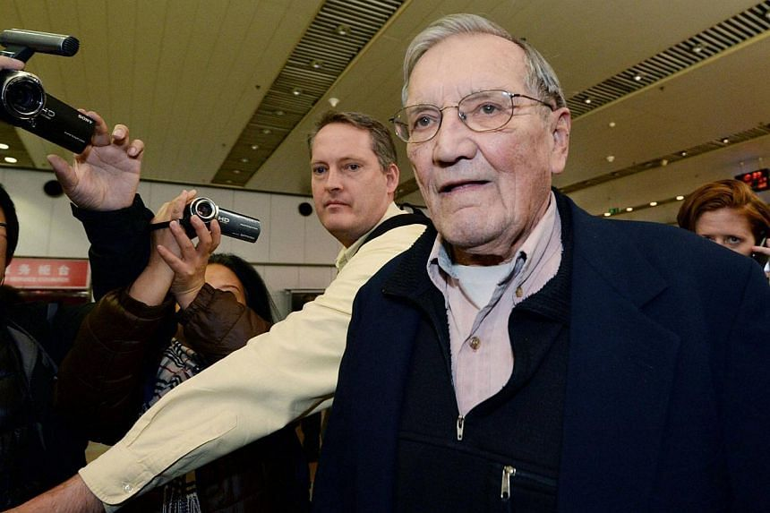 Veteran United States soldier Merrill Newman (centre), who was detained for over a month in North Korea, arrives at Beijing airport in Beijing, in this photo taken by Kyodo on December 7, 2013. Mr Newman, 85, arrived in China on Saturday after being