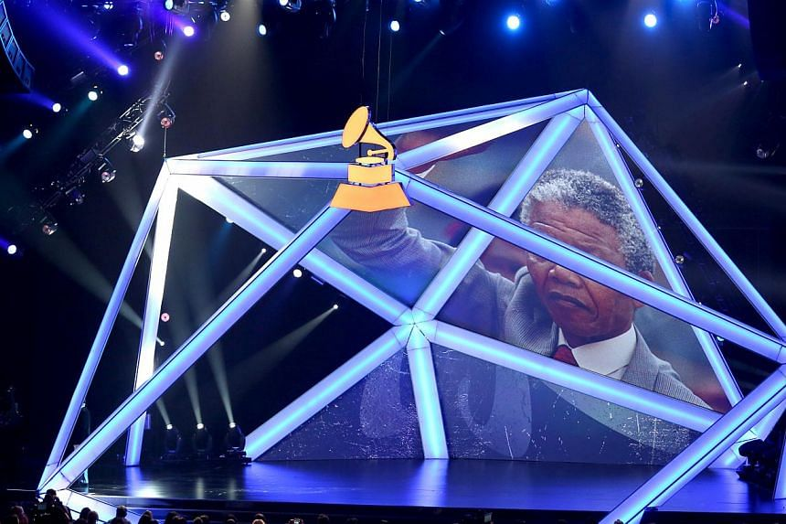 An image of Mr Nelson Mandela appears on screen at the Grammy Nominations Concert Live! on Dec 6, 2013, at the Nokia Theatre LA Live in Los Angeles. Hollywood has a long history with Mr Mandela, whose life story was seemingly made for the big screen