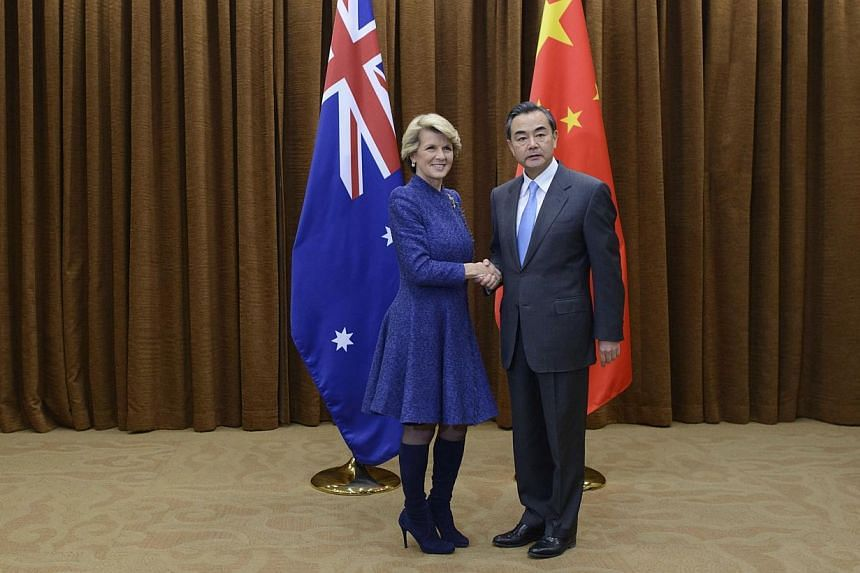 Australia's Foreign Minister Julia Bishop (left) shakes hands with her China's counterpart Wang Yi (right) prior to their talks at the Foreign Ministry in Beijing, on Friday, Dec 6, 2013. Australian Foreign Minister Julie Bishop downplayed tensions o