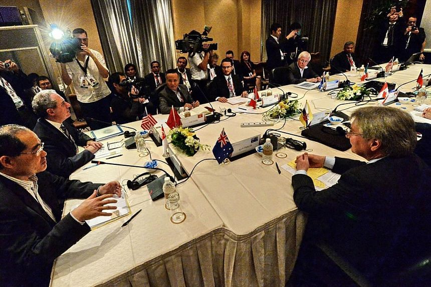 Trade ministers and representatives attend the Trans-Pacific Partnership (TPP) Ministerial Meeting in Singapore, on Dec 7, 2013. Trade ministers and officials from 12 countries arrived in Singapore on Saturday, Dec 7, 2013, for the start of the Trans