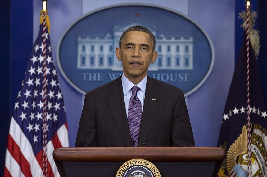 President Barack Obama speaks in the briefing room of the White House in Washington on Thursday, Dec 5, 2013, about the death of Nelson Mandela.When Mr Obama joins a roll-call of world leaders at next week's memorials for the late South African