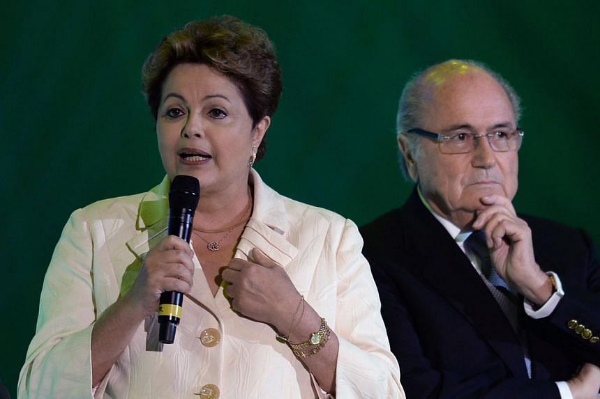 Brazilian President Dilma Rousseff (left) speaks next to Fifa president Sepp Blatter during the final draw of the Brazil 2014 Fifa World Cup, in Costa do Sauipe, Bahia state, Brazil, on Dec 6, 2013. Brazil will host the greatest-ever World Cup footba