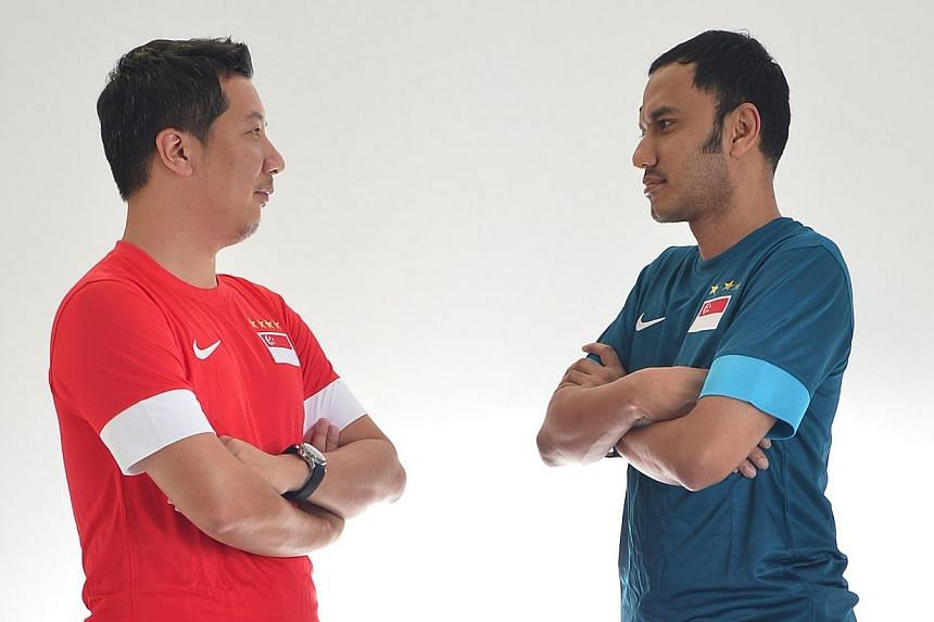 Straits Times sports editor Marc Lim (left) and communities and analytics editor Ernest Luis give their predictions on how the 2014 Fifa World Cup finals may play out.-- ST PHOTO:ASHLEIGH SIM