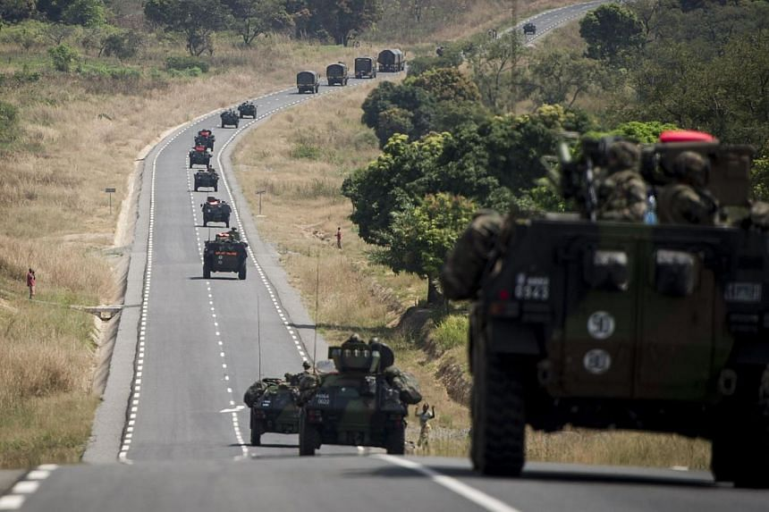 French militaries, arriving from Cameroon, drive on a road leading to Bouar, on Saturday, Dec 7, 2013.All 1,200 French troops pledged for a United Nations-mandated force in the violence-hit Central African Republic have now deployed, France's D