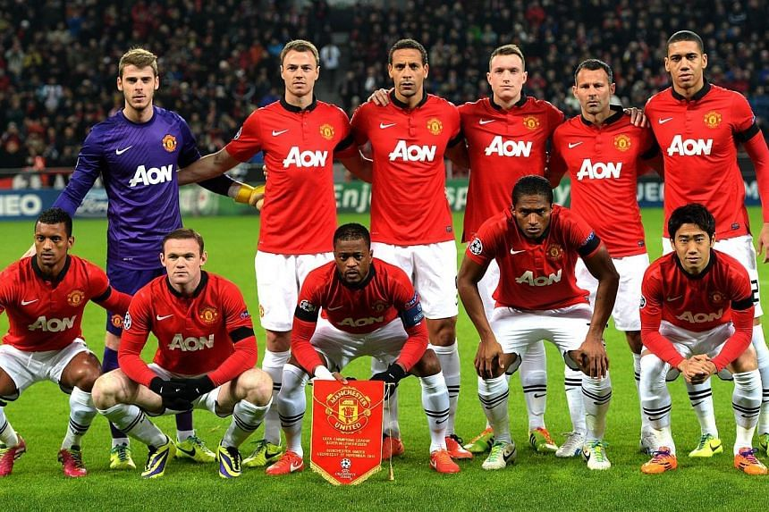 Manchester United's players pose for the team photo prior to UEFA Champions League Group A football match Bayern Leverkusen vs Manchester United in Leverkusen, western Germany, on Nov 27, 2013.Manchester City manager Manuel Pellegrini insists i