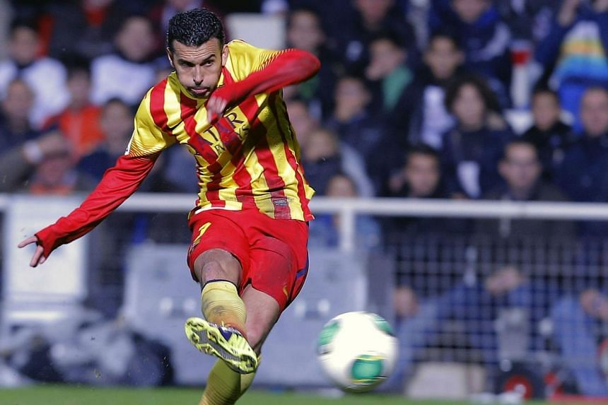 Barcelona conceded a surprise early goal but a double from Pedro Rodriguez helped them fight back to secure a 4-1 victory at third-tier Cartagena in their King's Cup last 32, first leg on Friday. -- PHOTO: AFP