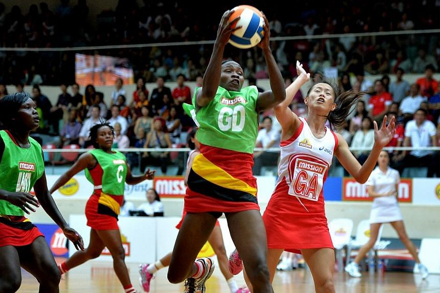 Singapore missed out on a chance at regaining a trophy they last lifted in 2007 when the national netball team were beaten 52-29 Saturday by Uganda in the final of the Nations Cup. -- TNP PHOTO:ARIFFIN JAMAR