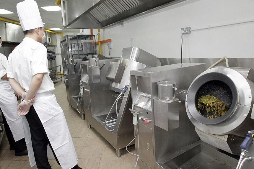 Chefs wait while Cooking Machines do their work at Tung Lok on Dec 6, 2013. -- ST PHOTO: CHEW SENG KIM