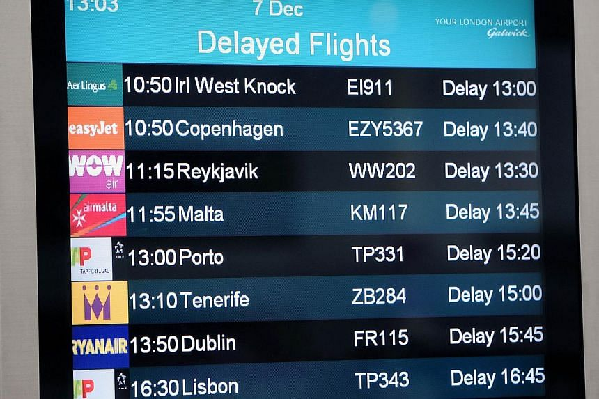 """A screen displays delayed flights at Gatwick Airport in southern England on Dec 7, 2013. A """"technical problem"""" in Britain's air traffic control systems caused widespread flight delays and cancellations across the country's airspace. -- PHOTO: AFP"""